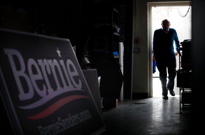 Democratic presidential candidate Sen. Bernie Sanders, I-Vt., uses the back entrance of his New Hampshire headquarters, before a new conference, Thursday, Feb. 6, 2020 in Manchester, N.H.  (AP Photo/Pablo Martinez Monsivais)