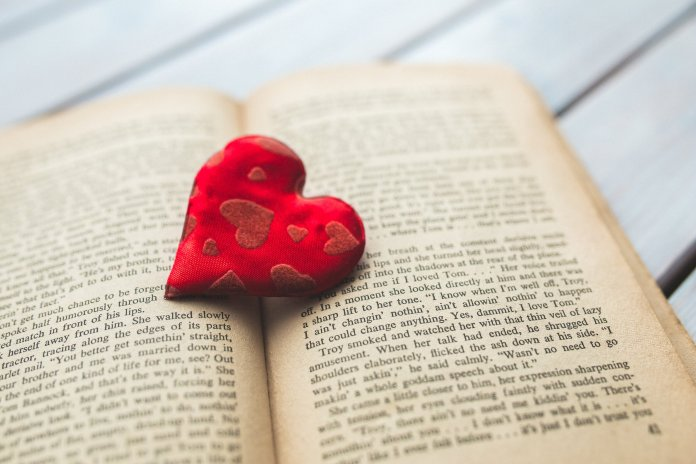A photo of a book with a heart on it. There are plenty of choices for books to read on Galentine's Day below. Photo by   Kaboompics .com   from   Pexels
