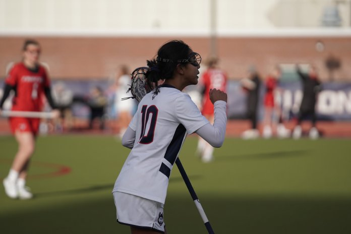 Lia Laprise sprints down the sideline during the UConn win over Fairfield. Laprise scored a pair of goals in the 19-13 victory.  Photo by Eric Wang/The Daily Campus