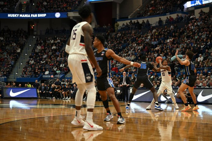 Christian Vital scored a team high 23 points in the victory. He also went 9--9 from the free throw line and was a stabilizing force for the Huskies.  Photo by Maggie Chafouleas/The Daily Campus.