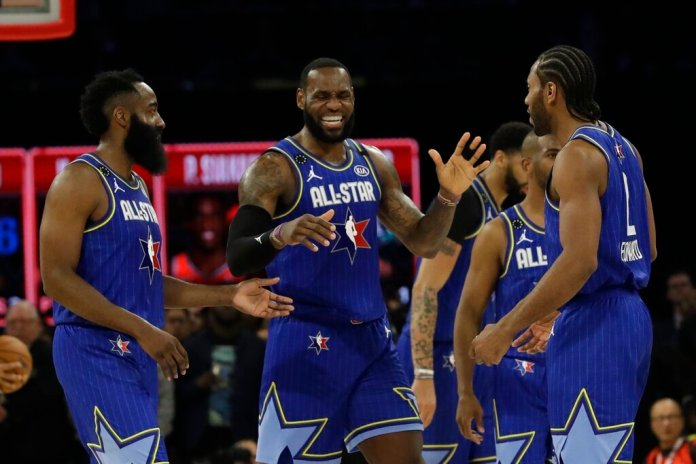 LeBron James of the Los Angeles Lakers celebrates with James Harden of the Houston Rockets and Kawhi Leonard of the Los Angeles Clippers during the second half of the NBA All-Star game Sunday in Chicago.  Photo courtesy of Nam Huh/AP
