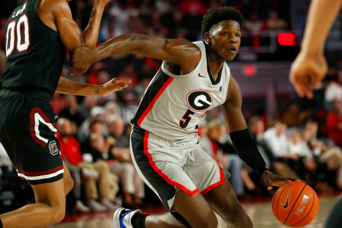Georgia's Anthony Edwards is defended by South Carolina's AJ Lawson during a game Wednesday in Athens, Ga.  Photo courtesy of Joshua L. Jones/Athens Banner-Herald via AP