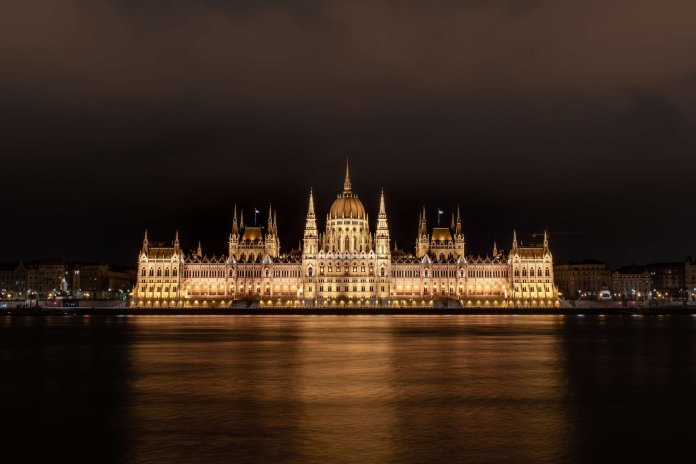 A photo of the Hungarian Parliament building at night. The author explored the Hungarian Parliament during her time in Budapest.  Photo by    Jason Blackeye    on    Unsplash