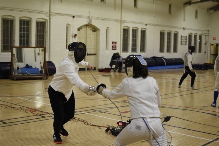 The UConn Fencing Club practices at Hawley Armory on Monday night. Members of the club will be attending the New England Intercollegiate Fencing Conference Championships at Vassar College on Feb. 22.  Photos by Brandon Barzola/The Daily Campus