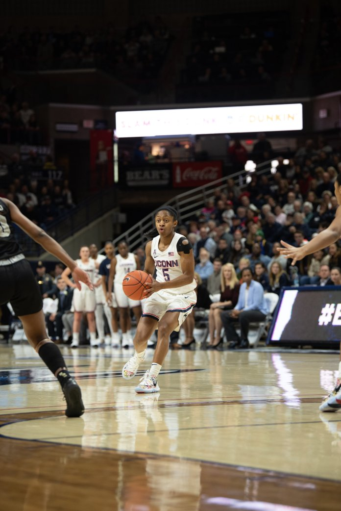 In her senior night, Crystal Dangerfield played all 40 minutes, scoring 14 points and grabbing two rebounds. The Huskies won the game 66-53.  Photo by Charlotte Lao/The Daily Campus.