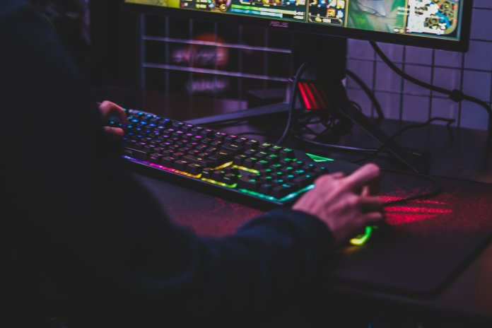A person playing a video game on their computer. This week, League of Legends team Cloud9 continued their undefeated season and are now ranked No. 1 overall.  Photo courtesy of Emmanuel via Unsplash