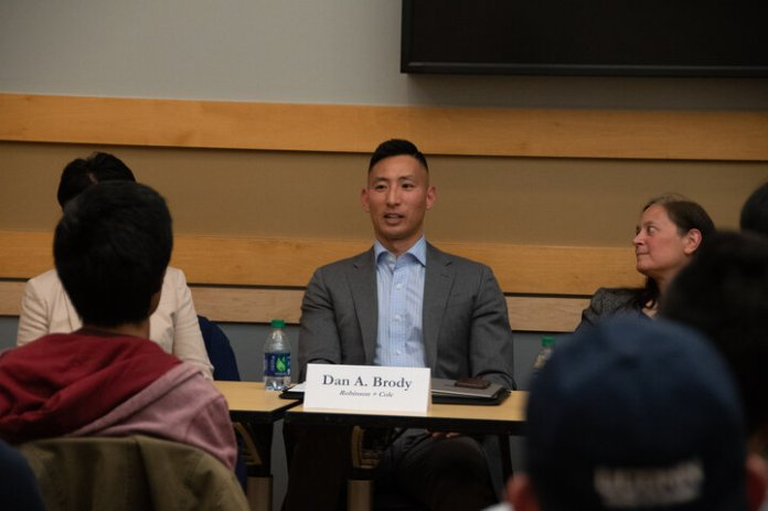 Dan Brody works at Robinson and Cole focusing on white collar defense, government enforcement and internal investigation, and was the sole panelist who did not have a scientific background, instead graduating with an English degree.  Photo by Avery Bikerman / The Daily Campus