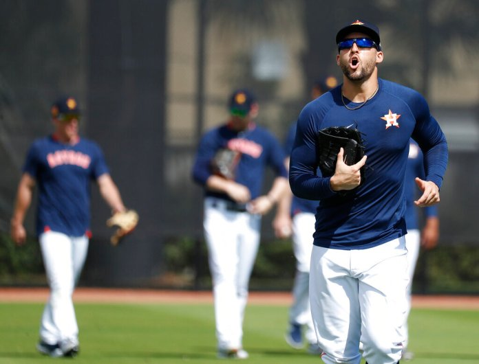 Houston Astros outfielder George Springer yells as he and other outfielders come off the field during baseball spring training Wednesday.  Photo courtesy of Karen Warren/Houston Chronicle via AP