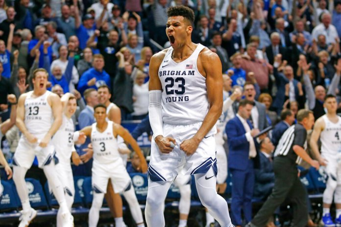 BYU forward Yoeli Childs reacts after dunking against Gonzaga during the second half of an NCAA college basketball game Saturday.  Photo courtesy of Rick Bowmer/AP