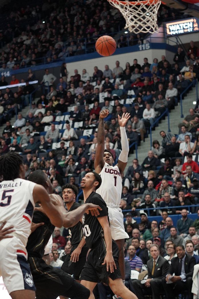 UConn's Christian Vital pulls up from deep against UCF. Vital and Isaiah Whaley led the team with 18 points each, and James Bouknight added 16 points as well.  Photo by Eric Wang/The Daily Campus