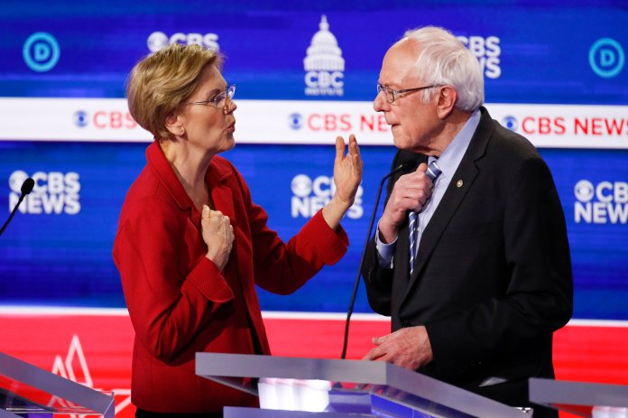 """Democratic presidential candidates, Sen. Elizabeth Warren, D-Mass., left, talks with Sen. Bernie Sanders, I-Vt., right, on stage after the Democratic presidential primary debate at the Gaillard Center, Tuesday, Feb. 25, 2020, in Charleston, S.C. During  Tuesday's debate  , Sanders stated that """"when dictatorships, whether it be the Chinese or the Cubans, do something good, you acknowledge that.""""  Photo by Patrick Semansky / AP Photo"""