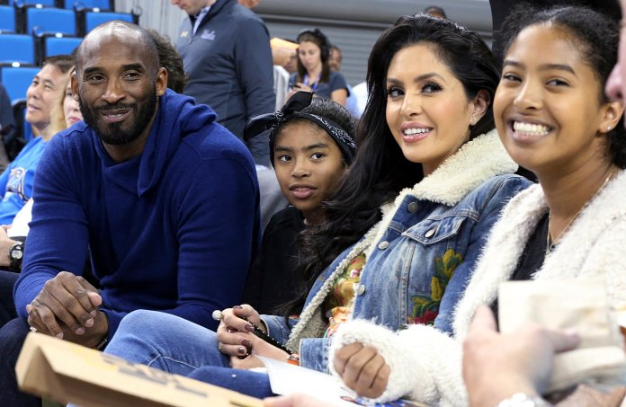 In this Nov. 21, 2017 file photo, from left, Los Angeles Lakers legend Kobe Bryant, his daughter Gianna Maria-Onore Bryant, wife Vanessa and daughter Natalia Diamante Bryant are seen before a Connecticut-UCLA NCAA women's basketball game in Los Angeles. Kobe Bryant's widow on Monday, Feb. 24, 2020, sued the owner of the helicopter that crashed in fog and killed the former Los Angeles Lakers star and their 13-year-old daughter Gianna last month. The wrongful death lawsuit filed by Vanessa Bryant in Los Angeles Superior Court said the pilot was careless and negligent by flying in cloudy conditions Jan. 26 and should have aborted the flight.  Photo by Reed Saxon, File / AP Photo