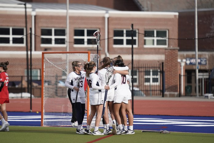 The UConn women's lacrosse team celebrated a 19-12 victory at home on Wednesday, Feb. 12. They look to take on Quinnipiac this weekend.  Photo by Eric Wang/The Daily Campus
