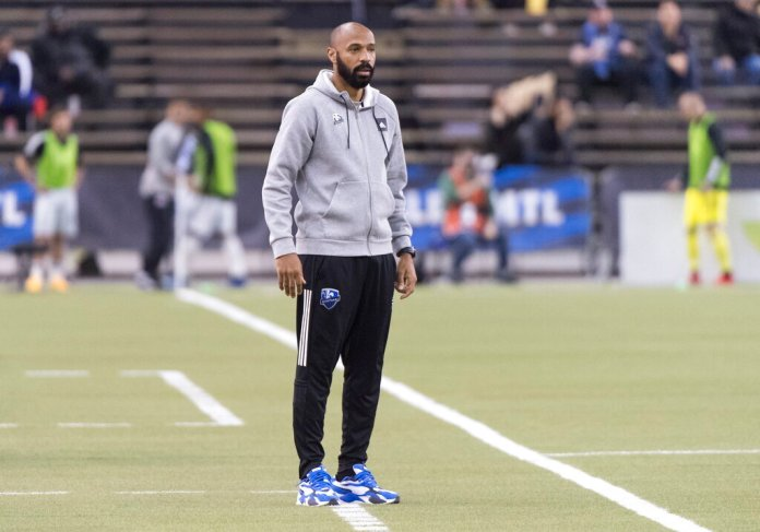 Montreal Impact head coach Thierry Henry looks on during second half of an MLS soccer game against the New England Revolution in Montreal, Saturday, Feb. 29, 2020.  Photo by Graham Hughes/AP