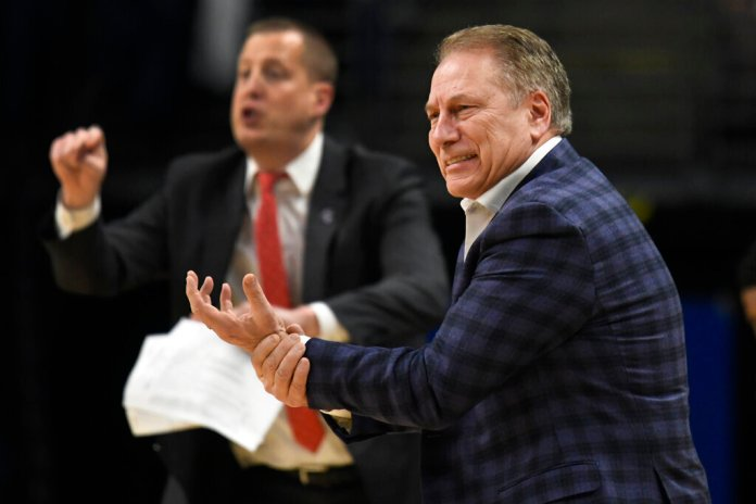 Michigan State coach Tom Izzo reacts reacts during the first half of the team's game against Penn State, Tuesday.  Photo courtesy of John Beale/AP