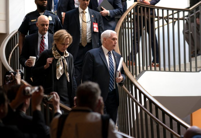 Vice President Mike Pence, center, joined at left by Dr. Deborah Birx, the coronavirus response coordinator, arrives at the Capitol to brief House members on the COVID-19 outbreak, in Washington, Wednesday, March 4, 2020. Congressional negotiators have reached agreement on an $8.3 billion bill to fund the government's response to the public health emergency.  Photo courtesy of J. Scott Applewhite / AP Photo.