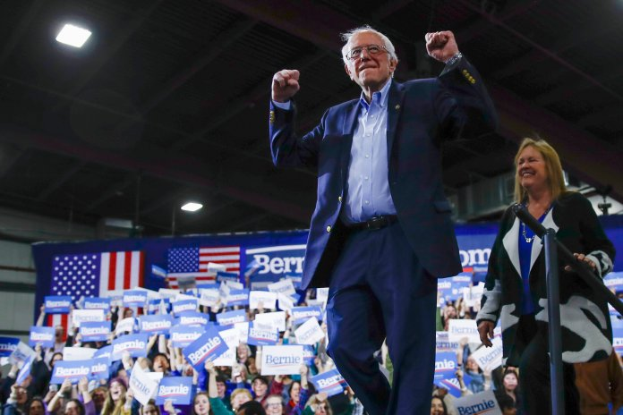 Democratic presidential candidate Sen. Bernie Sanders, I-Vt., accompanied by his wife Jane O'Meara Sanders, arrives to speak during a primary night election rally in Essex Junction, Vt., Tuesday, March 3, 2020.  Photo courtesy of Matt Rourke / AP Photo.