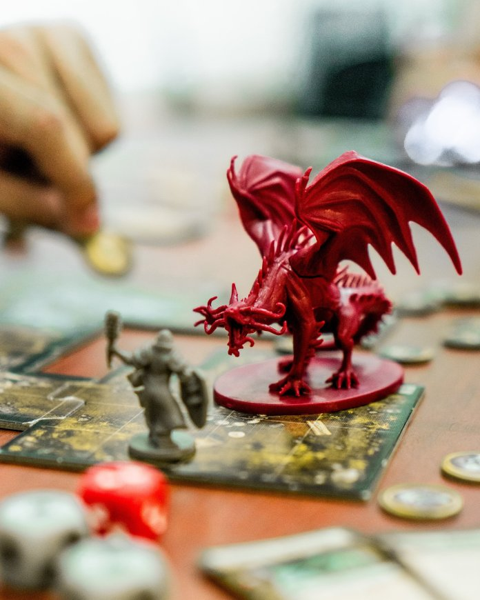 A photo of a Dungeons and Dragons game in progress. Dungeons and Dragons is a popular tabletop role-playing game that is prevalent at conventions.  Photo by    Clint Bustrillos    on    Unsplash