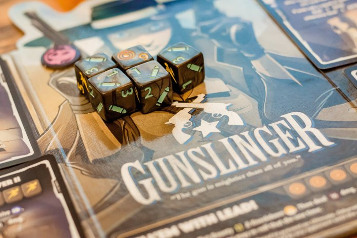 Gunslinger is a board game where the players find themselves in the wild west. All sorts of different board games can be found at conventions.  Photo by    Ryan Wallace    on    Unsplash