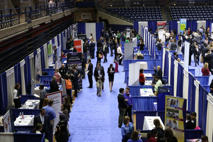 Students navigate UConn's spring career fair, put on by the Center for Career Development in Gampel Pavilion on Wednesday. Dozens of employers sent representatives to speak with students about full-time opportunities, internships, and more.  File photo/The Daily Campus