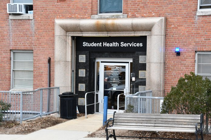 Students go in and out of the Student Health Services building. University of Connecticut President Thomas Katsouleas and university communications released separate emails last week detailing precautionary measures the university is taking in preparation for a COVID-19 outbreak.  Photo by Julie Spillane/The Daily Campus