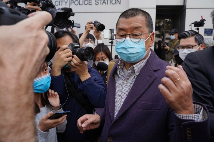 Founder of Hong Kong's Apple Daily newspaper, Jimmy Lai, walks out from a police station after being bailed out in Hong Kong, Friday, Feb. 28, 2020. Hong Kong's Apple Daily newspaper says the outspoken head of its publishing group, Lai, has been held by police over his participation in a protest march in August that was part of a months-long pro-democracy movement.  Photo courtesy of Lam Chun Tung / The Initium Media via AP.