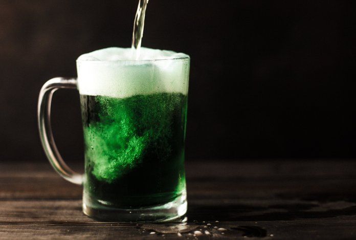 A photo of a green beer. Dying your beer green is a great way to get into the St. Patrick's Day spirit.  Photo by   Patrick Fore   on   Unsplash