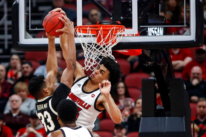 Louisville forward Jordan Nwora blocks the shot of Wake Forest forward Ody Oguama during the first half of a game in Louisville, Ky. Nwora was selected to the Associated Press All-ACC team selected Tuesday.  Photo by Wade Payne/AP