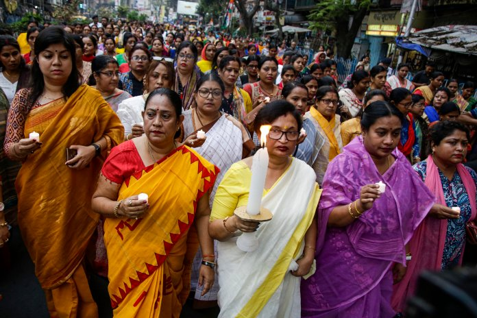 Women leaders of Trinamool Congress party calling for harmony and protesting communal violence in New Delhi walk during a peace march in Kolkata, India.  Photo by Bikas Das/AP.