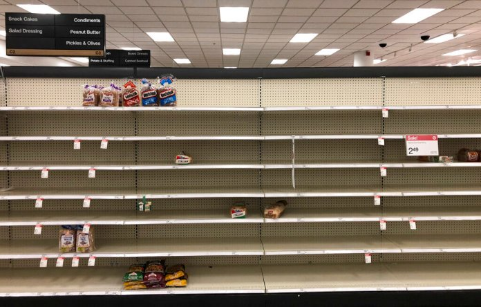 Shelves usually stocked with bread lay nearly empty at a Target in Abington, Pa., Wednesday, March 18, 2020. Coronavirus concerns have led to consumer panic buying of grocery staples.  Photo by Matt Rourke/AP