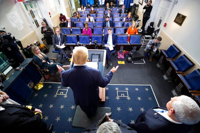President Donald Trump speaks about the coronavirus in the James Brady Briefing Room, Monday, March 23, 2020, in Washington.  Photo by Alex Brandon/AP
