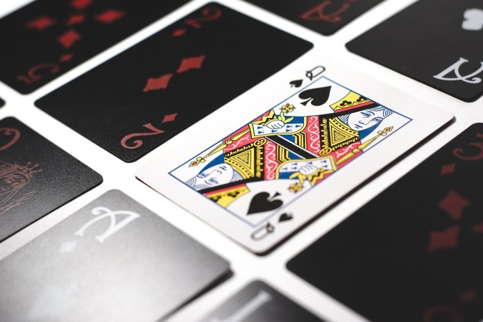Needing something to pass the time? Here are some fun card games to enjoy while in quarantine.  Photo by    Esteban Lopez    on    Unsplash