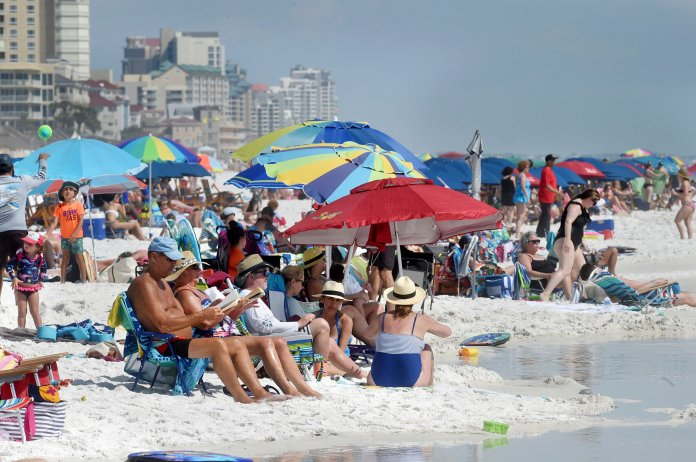 People gather onthe shoreline in Destin, Fla., Wednesday, March 18, 2020.   Why does it seem like so many people in our communities, especially our peers as university students, are still not taking this virus seriously?  Devon Ravine/Northwest Florida Daily News via AP