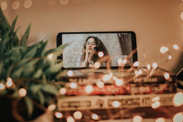 A photo of a girl on FaceTime. FaceTiming is a great way to stay connected with friends and family during quarantine.  Photo by    Dollar Gill    on    Unsplash