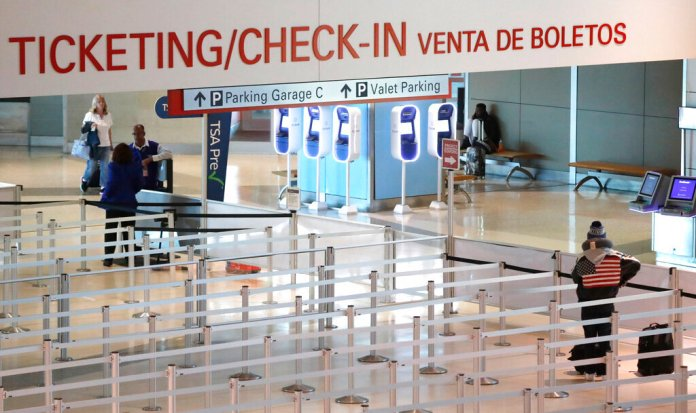 In this March 12, 2020, file photo, an empty security queue awaits travelers at Love Field airport in Dallas. Texas joined other states Thursday, March 26, 2020, in imposing quarantines on travelers from the New York area.  Photo by LM Otero/AP