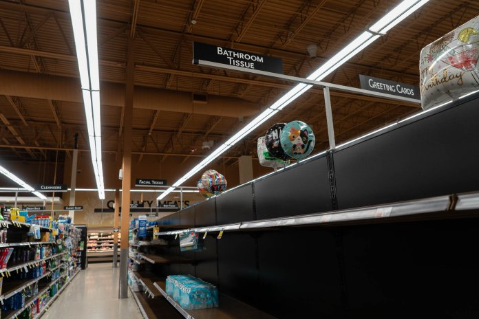 The Price Chopper in Storrs, Connecticut remains well stocked in comparison to some stores, but still bears empty shelves of canned goods, toilet paper, paper towels, and disinfecting products.  Photo by Maggie Chafouleas/The Daily Campus
