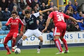 Brandon Ormonde-Ottewill of Swindon Town challenges Lee Gregory of Millwall for the ball.  Photo in the    public domain