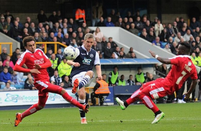 Steve Morison of Millwall shoots at goal during the game against Swindon Town.  Photo in the    public domain