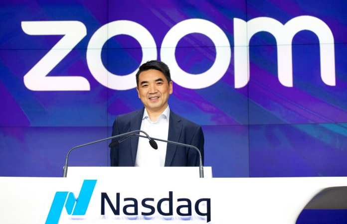 Zoom CEO Eric Yuan attends the opening bell at Nasdaq as his company holds its IPO in New York. Millions of people are now working from home as part of the intensifying fight against the coronavirus outbreak. They are being sued for the lack of security on the video calling service, according to Bloomberg.  Photo by Mark Lennihan, File/AP