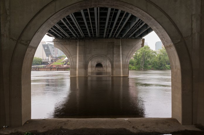 """A photo of Founders Bridge in Hartford, Connecticut. Janet said """"my Connecticut River project looks at the Connecticut River landscape, delineated by its watershed, as a complex set of interconnected systems where present bumps up against past in telling ways.""""  (Photo by Janet Pritchard)"""