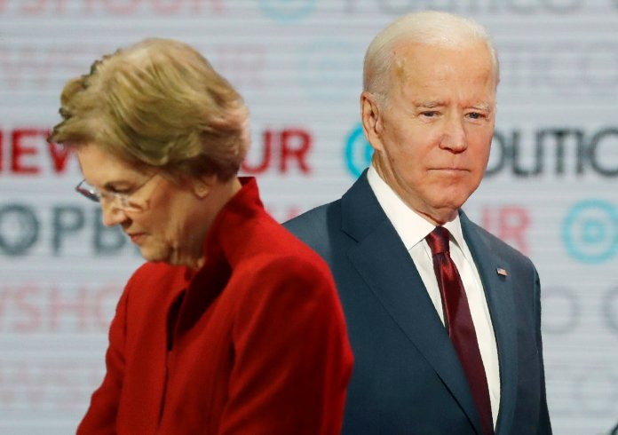 Presumptive Democratic presidential candidates Sen. Elizabeth Warren, D-Mass., left, and former Vice President Joe Biden stand on stage during a break at a Democratic presidential primary debate in Los Angeles.  File photocourtesy of Chris Carlson / AP Photo.
