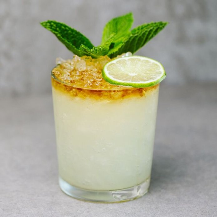 The first stop on this drinking around the world tour: The Caribbean with a classic Mai Tai cocktail.  Photo courtesy of Tim Nusog via    liquor.com.    Thumbnail photo courtesy of    Kobby Mendez    on    Unsplash   .