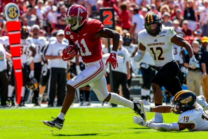 Alabama wide receiver Henry Ruggs runs in for a touchdown on a pass reception against Southern Mississippi during the first half of an NCAA college football game in Tuscaloosa, Ala. Several receivers are projected to go in the first round. Ruggs and Oklahoma's CeeDee Lamb are considered by many analysts to be the best of the bunch.  Photo by Vasha Hunt, File/AP