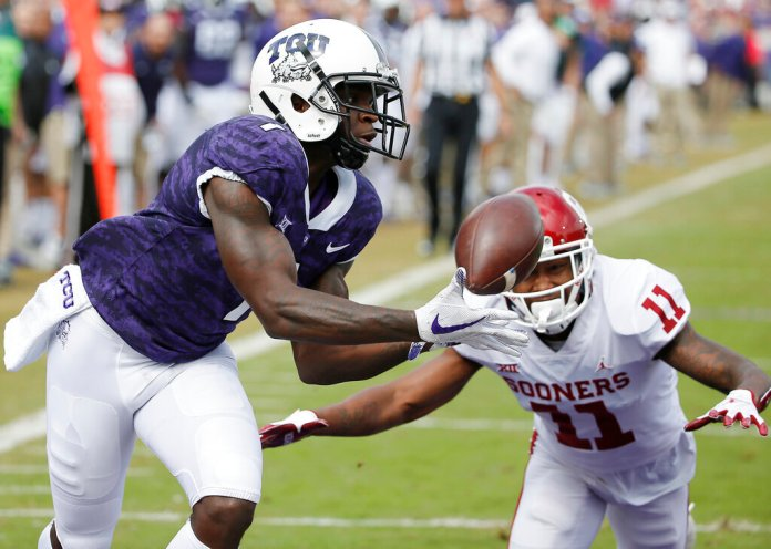 TCU wide receiver Jalen Reagor catches a touchdown as Oklahoma cornerback Parnell Motley defends him during the first half of their matchup in Fort Worth. Reagor is a possible pick in the NFL Draft which runs Thursday.  Photo by Brandon Wade, File/AP