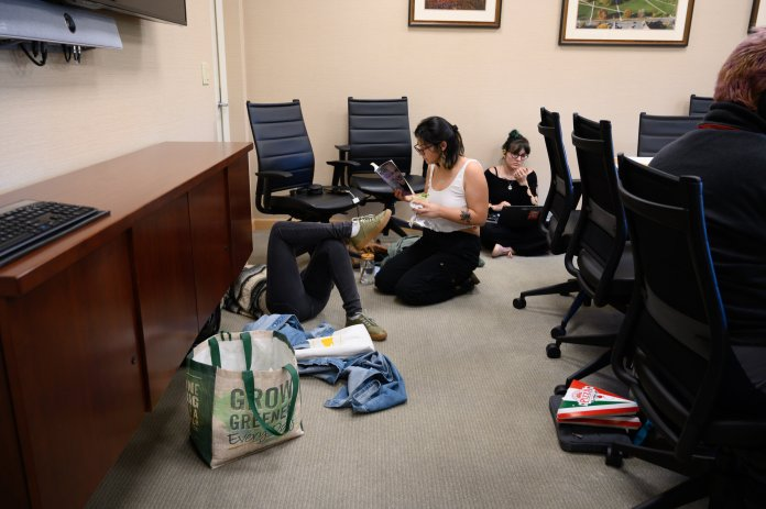 Members of the environmental activism group Fridays For Future stage a sit-in in Gulley Hall for the third week in a row on Friday, Oct. 18, 2019. President Katsouleas addressed the ongoing efforts the university is taking involving its work with fossil fuels.  Photo by Maggie Chafouleas / The Daily Campus.