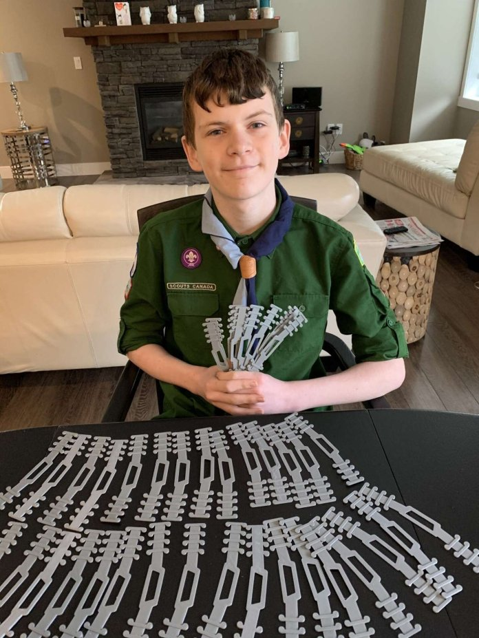 Quinn Callander, a 12-year-old boy from Canada, used a 3D printer to design ear guards for hospital workers.  Photo courtesy of    MSN