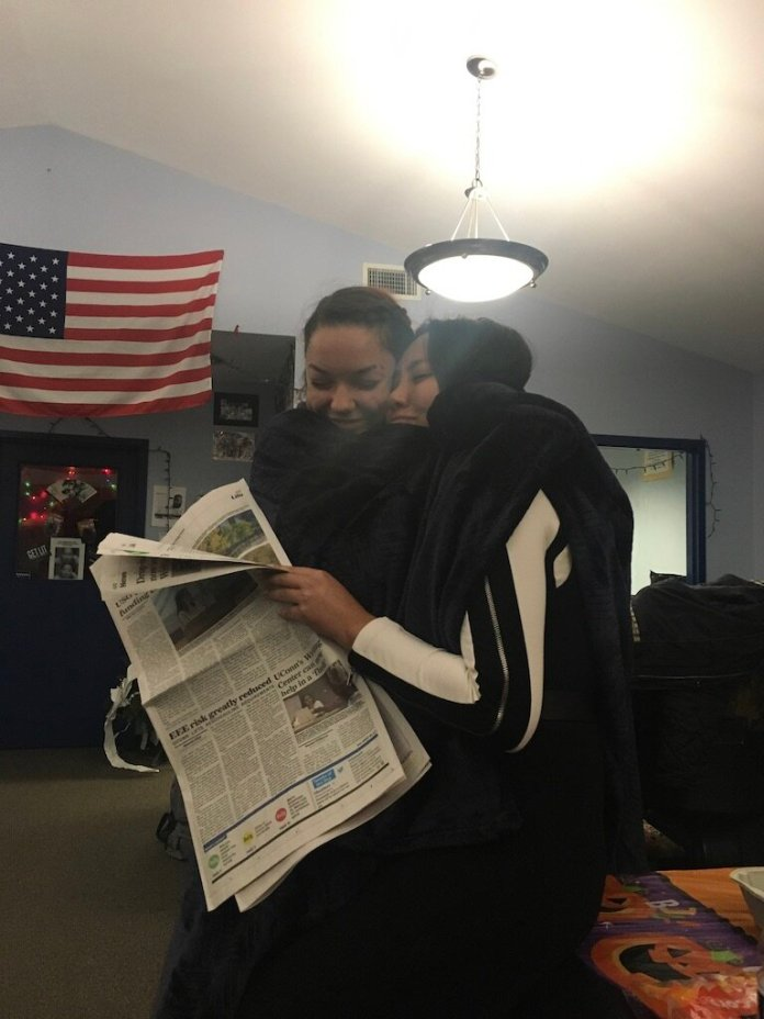 Kim and Courtney Gavitt, hugging.  Photo provided by author.
