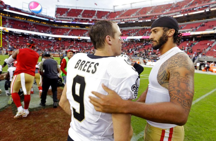 In this Nov. 6, 2016, file photo, San Francisco 49ers quarterback Colin Kaepernick, right, is greeted by New Orleans Saints quarterback Drew Brees at the end of an NFL football game in Santa Clara, Calif.  Photo by D. Ross Cameron/AP