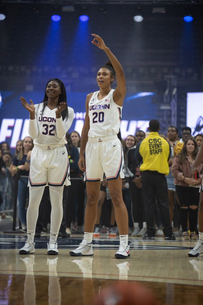 Olivia Nelson-Ododa cheers with Batouly Camara at First Night on Friday, Oct. 18, 2019. The women's basketball team arrived on campus two weeks ago. File photo/The Daily Campus