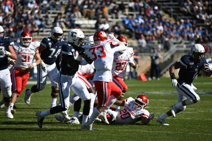 UConn football in a 2019 game. The team's fall 2020 season has been suspended.  Photo by Eric Wang/The Daily Campus
